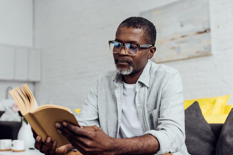 Older African American man reading book